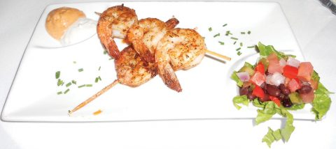 Grilled shrimp skewers are a good way to start a meal at Tarpon Lodge. DREW STERWALD/FLORIDA WEEKLY