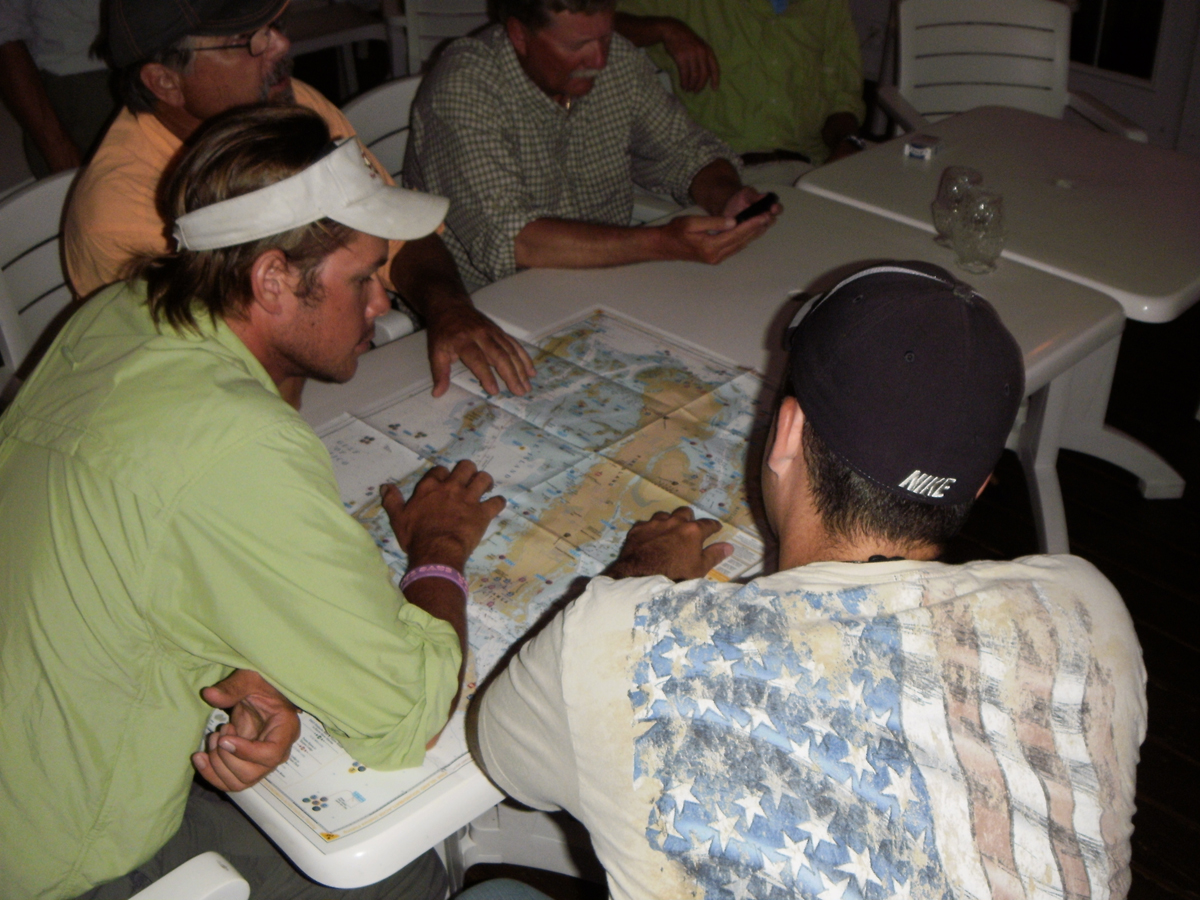 Kayak anglers comparing prospective fishing areas.