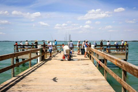 Fishing is a popular pastime on Sanibel Island. Here, crowds fish from a pier.