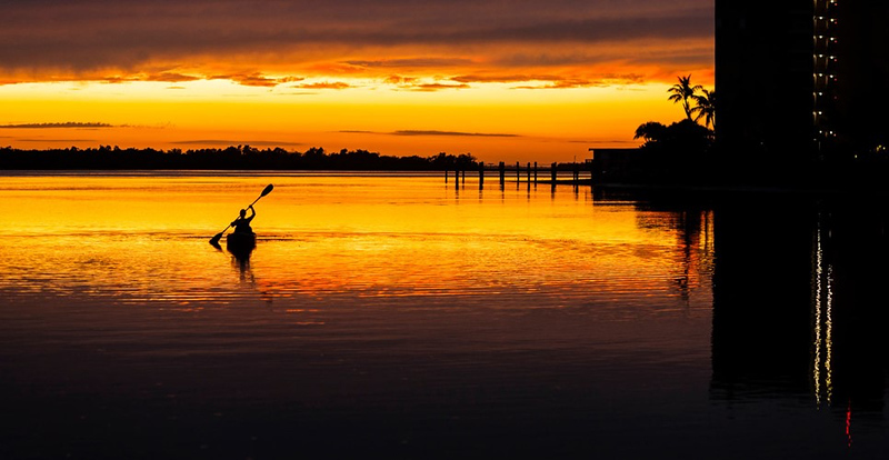 kayaker in the water at sunset